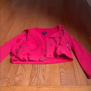 Pink blazer with zippers.